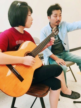 Instructor Hyunil Lee with student Joanna Kim